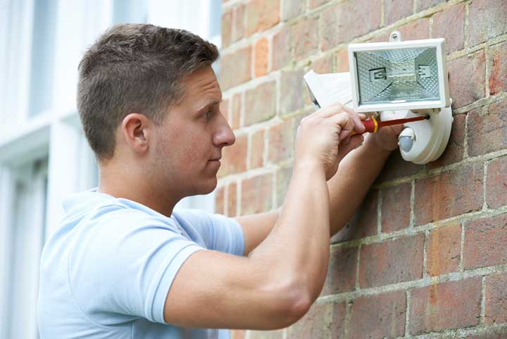 Outdoor safety lighting being installed by a professional
